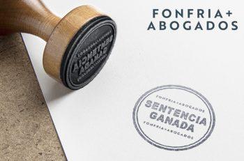 """Fonfria Abogados Sentencias Ganadas. Foto de un cuño con su impresión en papel que dice """"Sentencias ganadas"""""""
